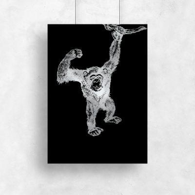 metaliczna dekoracja z małpką
