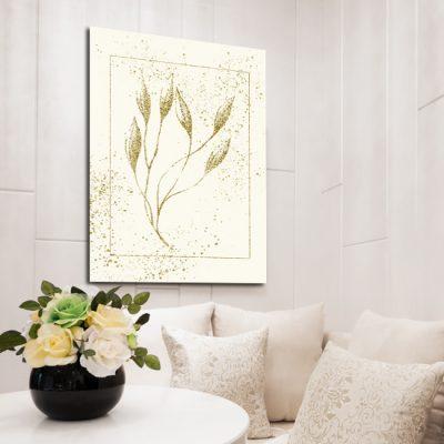 plakat w salonie z roślinką