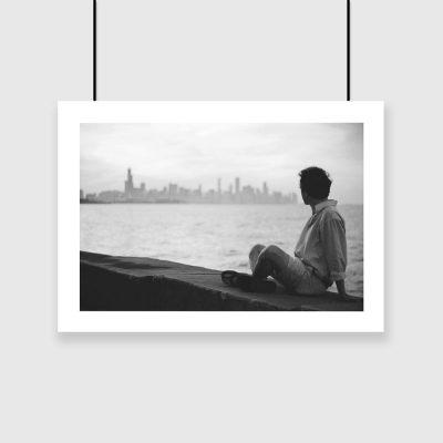 Plakat wieżowce i mężczyzna