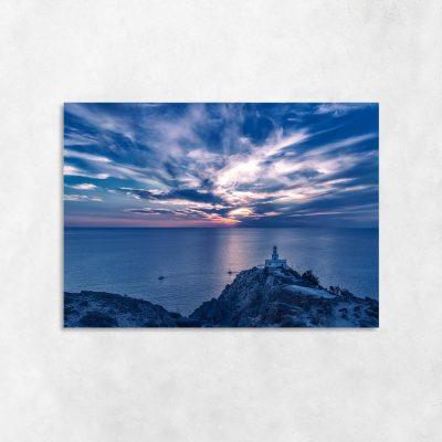 Obraz latarnia morska i zachód słońca