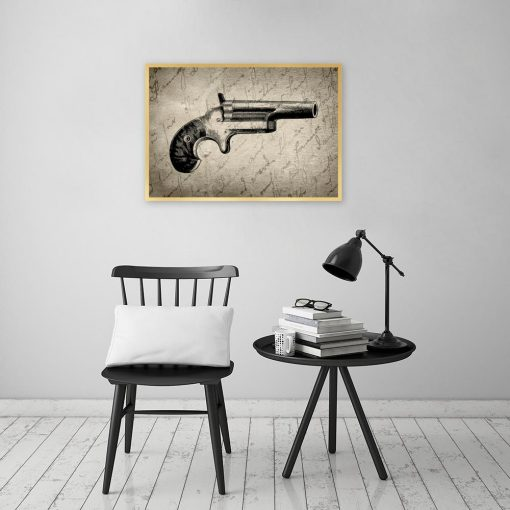 plakat ze starym rewolwerem na ścianę