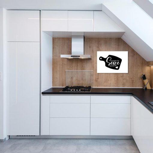 plakat czarno biały przedstawiający napis Kuchnia to serce domu