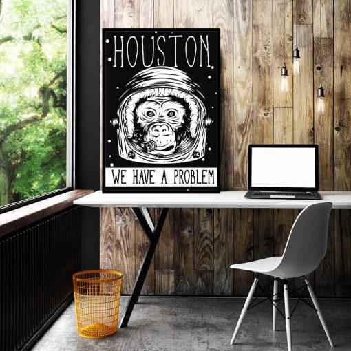 plakat z napisem po angielsku Houston we have a problem