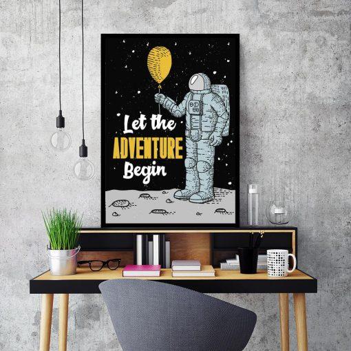 plakat z kosmonautą