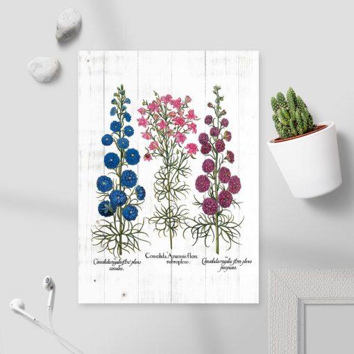 Plakat z polnymi kwiatami na tle desek