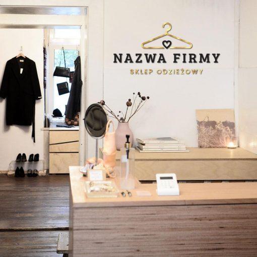 Ozdobny logotyp z nazwą firmy i wieszakiem do salonu odzieży